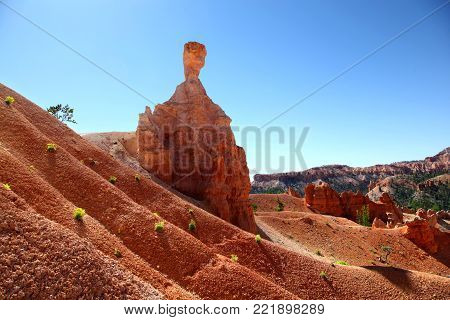 Thor's Hammer hoodoo silhouetted against the bright blue sky in Bryce Canyon National Park