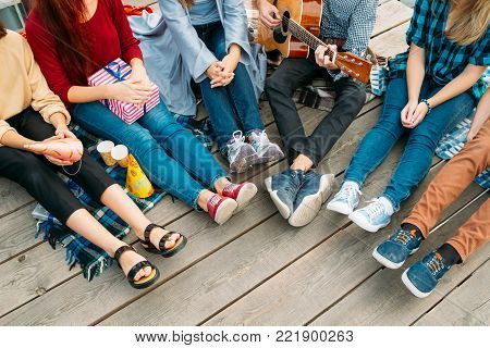 Youth leisure. Carefree young people sing songs play guitar and relax. Alternative subculture, unconventional views of life