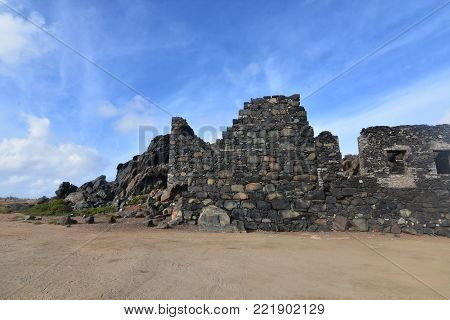 Gold mill ruins with a large wall still standing