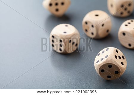 Dice on gray table. Board game. Gambling devices.