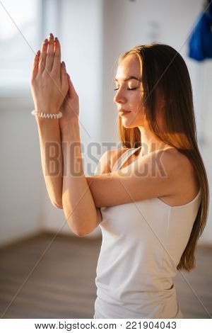 woman working out, doing yoga or pilates exercise. Gomukasana, Cow Face pose