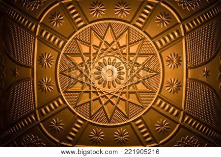 horizontal image of a golden glow to a background image of great design and pattern with copy space.