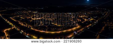 Aerial view of the city at night. Horizontal panorama.
