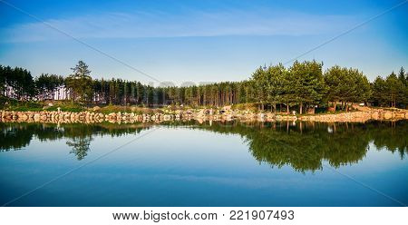 beautiful view of the pond in Lithuania with reflection in the water