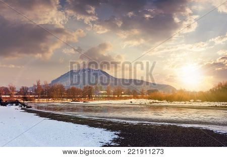 Tisza river in winter at sunset. countryside area near the Khust town in Ukraine
