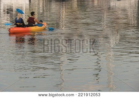 Woman and man kayakers on the water in Marina del Rey, California.