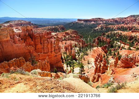 Red hoodoo and green pine filled landscape of Bryce Canyon National Park