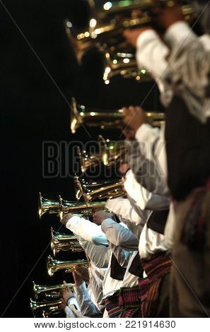 Big trumpet orchestra in row on the stage