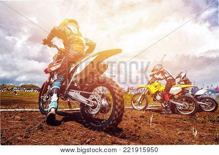 Dirtbike. Athlete bikers is start motocross sunset
