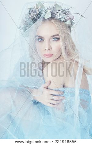 Charming Fairy Woman In A Blue Ethereal Dress And A Wreath On Her Head On White Background, Gentle M