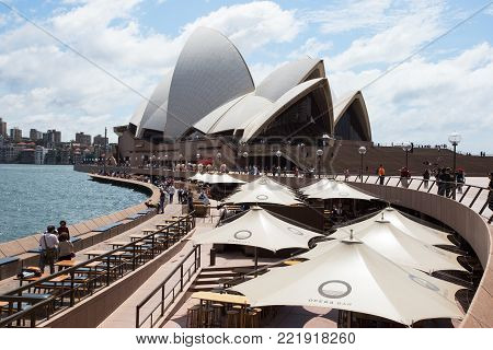 SYDNEY, AUSTRALIA - NOV 6, 2017: Tourists stroll along Circular Quay in front of the Opera House