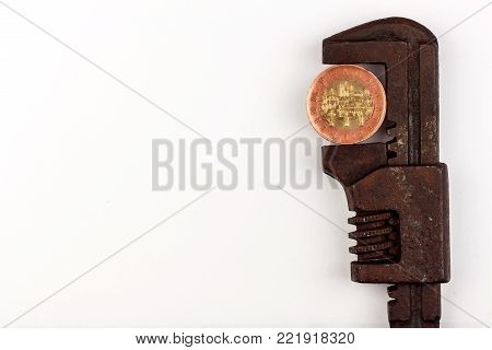 Czech coins in the clamp. Risk of economic crisis. The fall of the currency. On a white background.