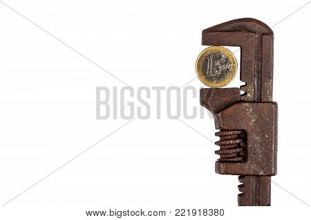 Euro coins in the clamp. Risk of economic crisis. The fall of the currency. Isolated on white