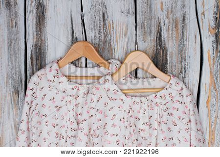 Cute designer nightgowns on rustic background. Soft cotton, ruffles and flowers. Limited collection, sale.