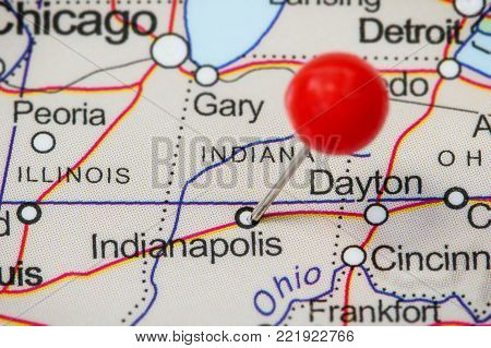 Close-up of a red pushpin in a map of Indianapolis, USA.