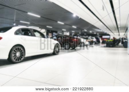 Blurred dealership store bokeh background, Cars soft lightning, Blur bokeh transportation concept dealer showroom background. Blurry