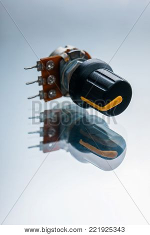 variable resistor on a white background. apparatus regulating the current and voltage in the electrical circuit poster