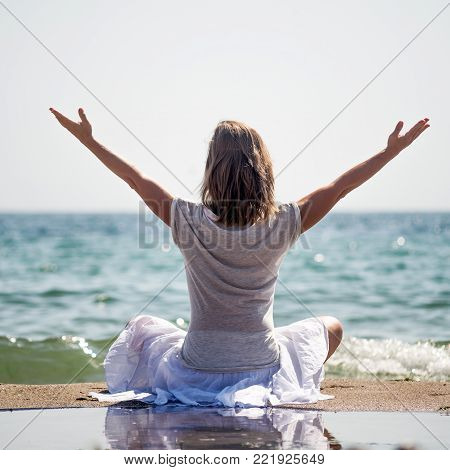 serenity and yoga practicing at the sea