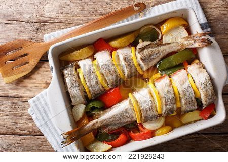 Atlantic Cod Baked With Vegetables In A Baking Dish Close Up. Horizontal Top View