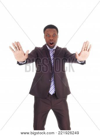 An African business man holds his hands up and mouths open and says NO, don't do this, isolated for white background