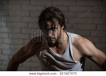 Sleepy man with beard undress. Insomnia, energy, single with uncombed hair. Barber and hairdresser, male fashion. Morning wake up, everyday life. Man with disheveled hair in underwear.