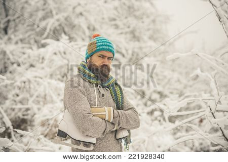 Man Lumberjack In Thermal Jacket With Ax.