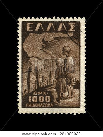 GREECE - CIRCA 1949: vintage canceled stamp printed in Greece shows kids near concentration camp, barbed wire, circa 1949. vintage postal stamp isolated on black background.