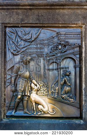 An old relief below the statue of St. John of Nepomuk on Charles Bridge in Prague, Czech Republic