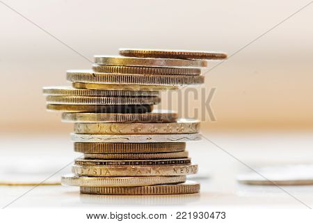 Close up photo of coins stacked on each other in different positions. Money concept.