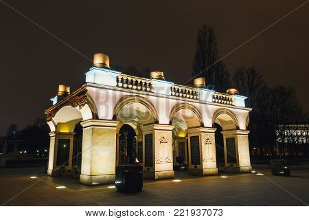 WARSAW, POLAND - March 12, 2016: Night view of the Tomb of the Unknown Soldiers with eternal flame at Pilsudski Square in Warsaw.