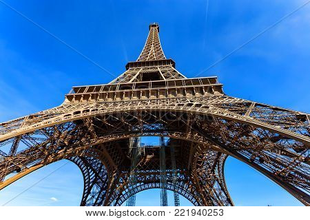 Beautiful scenic wide shot of Eiffel Tower with dramatic sky at late evening of summer day, Paris, France