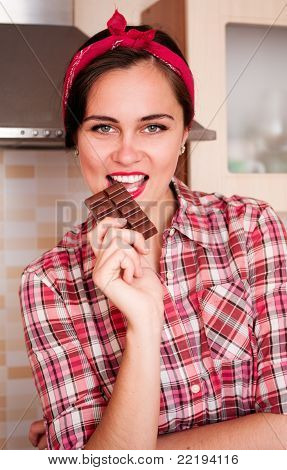Sexy Housewife Bites Chocolate Bar