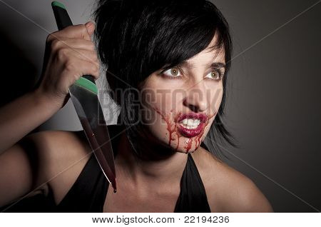 Crazy Cannibal Woman With Blood On Her Face