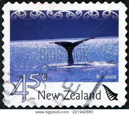 NEW ZEALAND - CIRCA 2004: a stamp from New Zealand shows image of a whale's tail, circa 2004