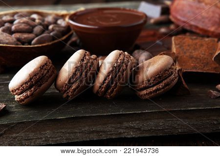 Sweet and colourful french macaroons or macaron on wooden background, Dessert