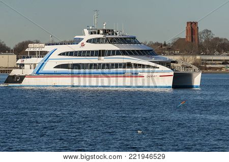 New Bedford, Massachusetts, USA - December 21, 2017: Outbound Hy-Line ferry Grey Lady IV in New Bedford harbor with Fairhaven in background