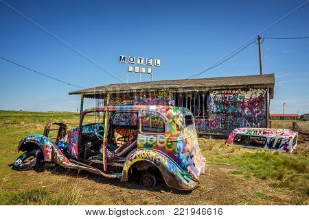 CONWAY, TEXAS, USA - MAY 12, 2016 : Bugg Ranch on Route 66. Bugg Ranch is a public  art installation of old car wrecks and a popular landmark on historic Route 66