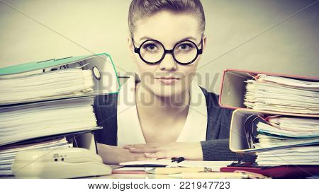 Paperwork administration bureau clerk concept. Young happy secretary at work. Office lady doing her job.
