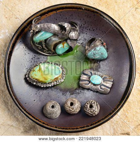 Antique Navajo silver and turquoise jewelry with pre columbian indian whirls.