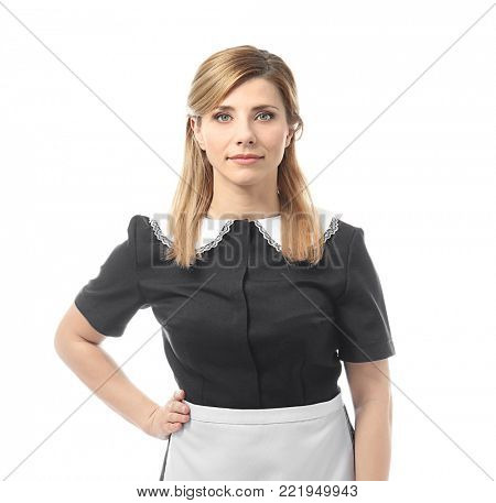 Young chambermaid in uniform on white background