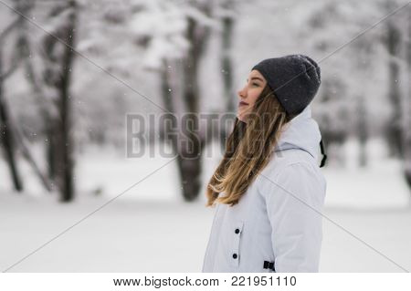 Back view of Casual woman portrait over winter landscape background. Tourist girl with backpack sightseeing over idyllic mountain scenery Alps view. Travel Lifestyle. Zugspitze, Germany. poster