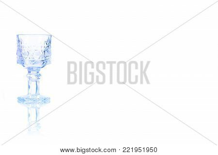 Shot of vodka toned in blue colorisolated on a white background. Place for your text.