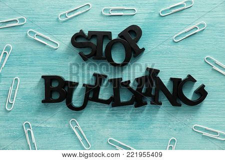 "Text ""Stop bullying"" on color background poster"