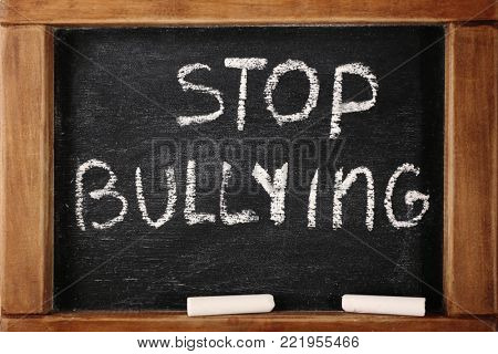 "Chalkboard with text ""Stop bullying"", closeup poster"