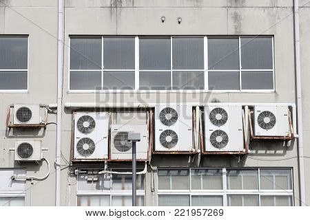 Air conditioners on the wall, Many compressor airs are hanging on a wall