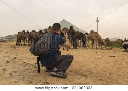 Unidentified tourist take photography in countryside of Pushkar city in rajasthan, India.