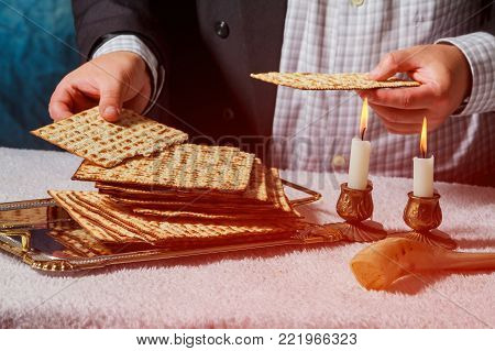 Sabbath kiddush ceremony composition with two wax candles in candlesticks and a traditional passover matzah fresh of bread