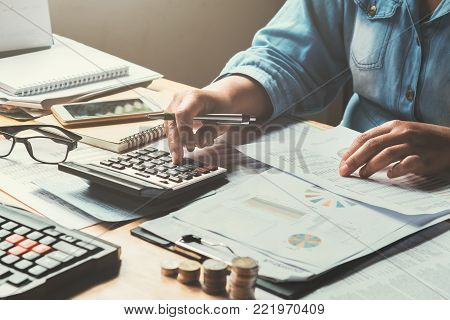business woman using calculator to calculate. accounting concept