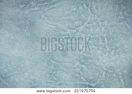 The colored heterogeneous leather texture. The fabric in light, dark blue and white tints. Artistic retouching. Perfect background for the different kinds of illustrations and collages.