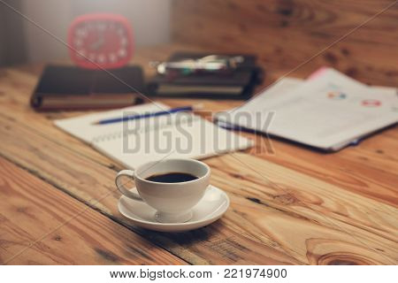 Business And Finance Concept Of Office Working,close Up Coffee On Office Desk In Working Hours